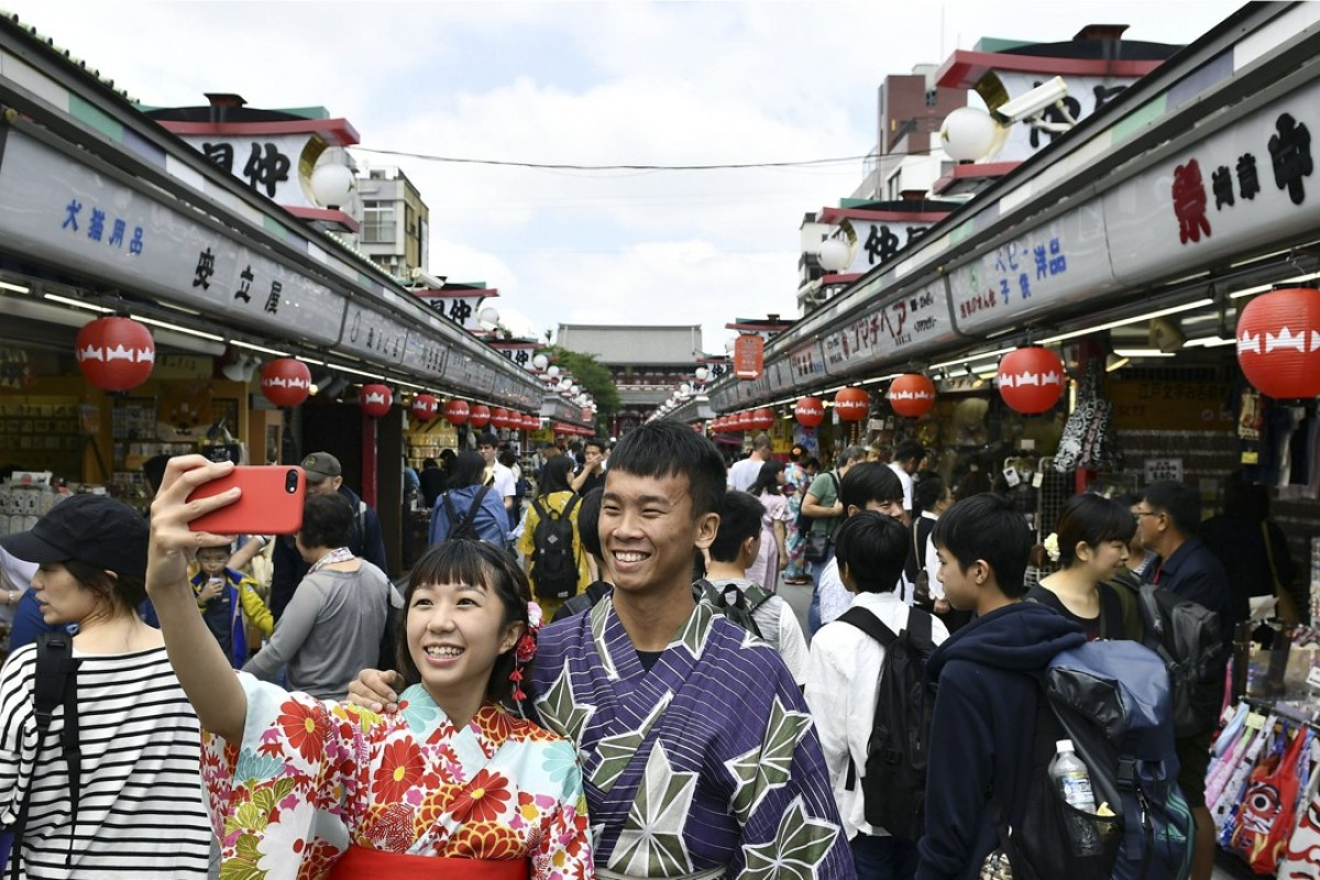 "Tourists on a busy street in Asakusa, Tokyo, contributing to what Japan is calling its ""tourism pollution"". Picture: Kyodo"