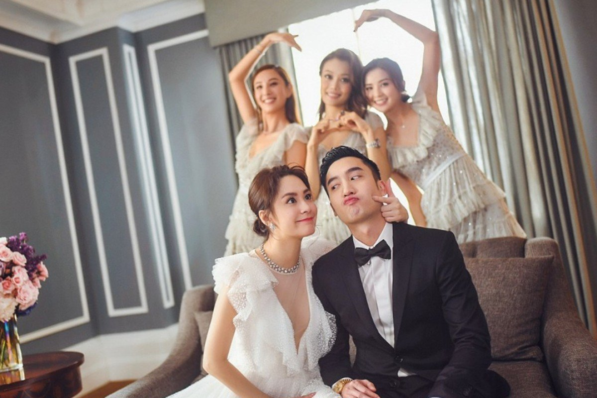 Hong Kong singer Gillian Chung and Taiwanese doctor Michael Lai (front) pose for a fun picture during the wedding celebration with their three bridesmaids (at the back, from left) Yumiko Cheng, Joey Yung and Charlene Choi.