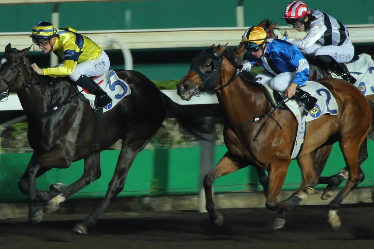 Chad Schofield drives Shimmer And Shine (left) to victory at Sha Tin on Wednesday night. Photos: Kenneth Chan