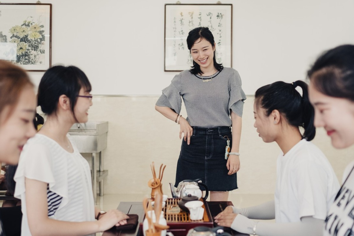 A teacher at China's Zhenjiang College introduces its all-female students to the tea ceremony. Picture: Yuyang Liu for The Washington Post