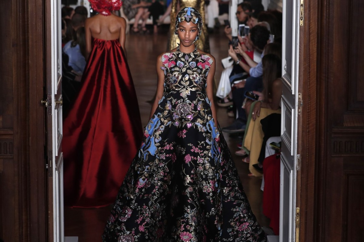 A model presents a beautifully proportioned floral creation, with a matching headdress during the Valentino autumn-winter 2018-19 collection show by Italian designer Pierpaolo Piccioli at Paris Haute Couture Fashion Week on Wednesday. Photo: EPA-EFE