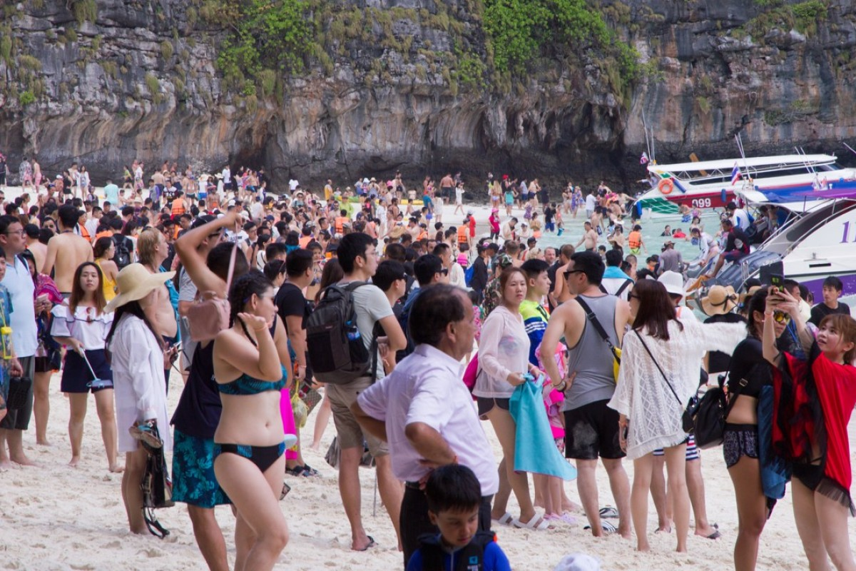 Tourists crowd Maya Bay in Thailand ahead of its closure due to overtourism on June 1.
