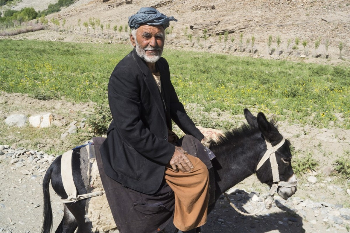 A local man on a donkey on the road between the Tajik border and Ishkashim. Photo: Edward Cavanough