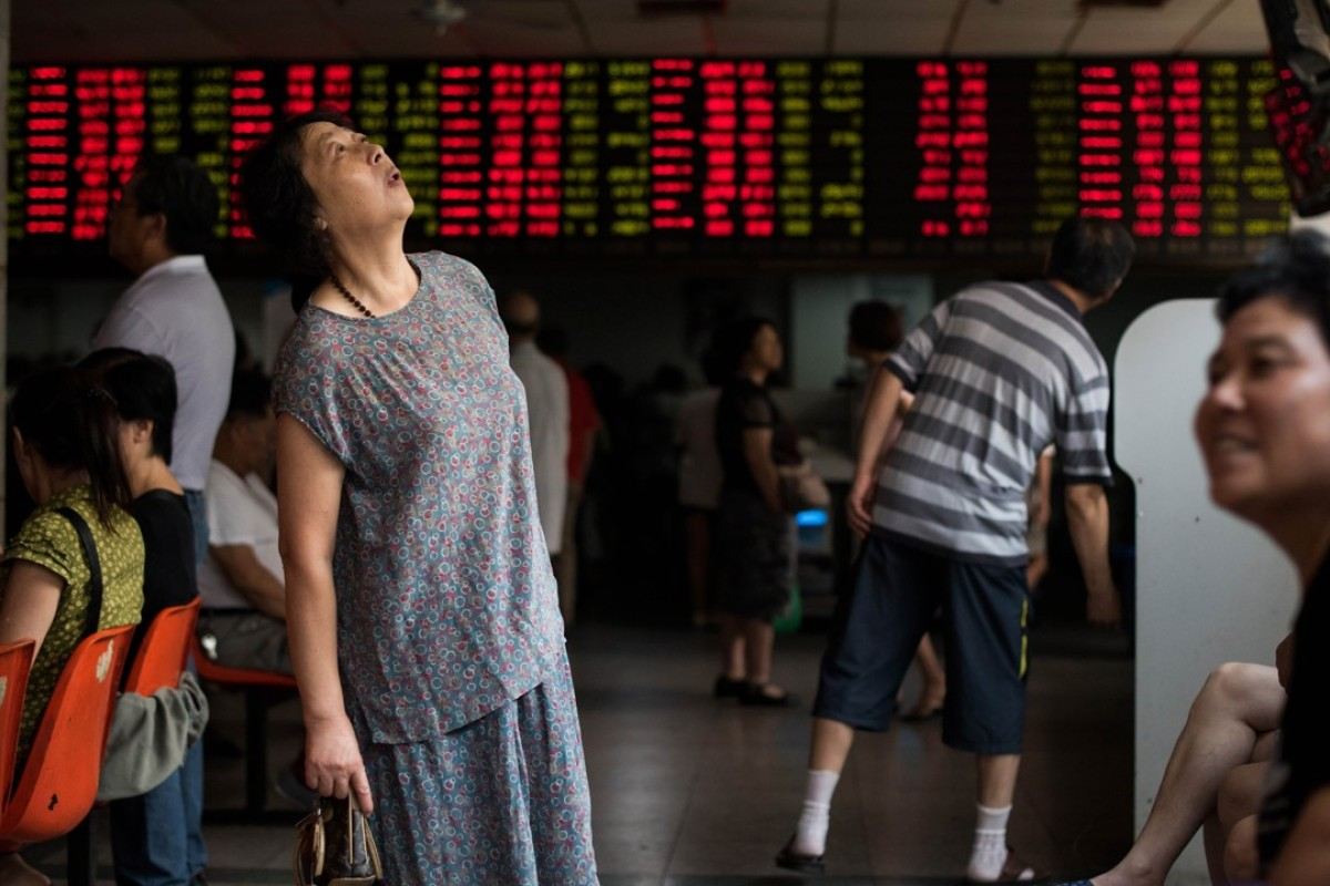 Investors monitor stock market movements at a brokerage house in Shanghai. Photo: AFP
