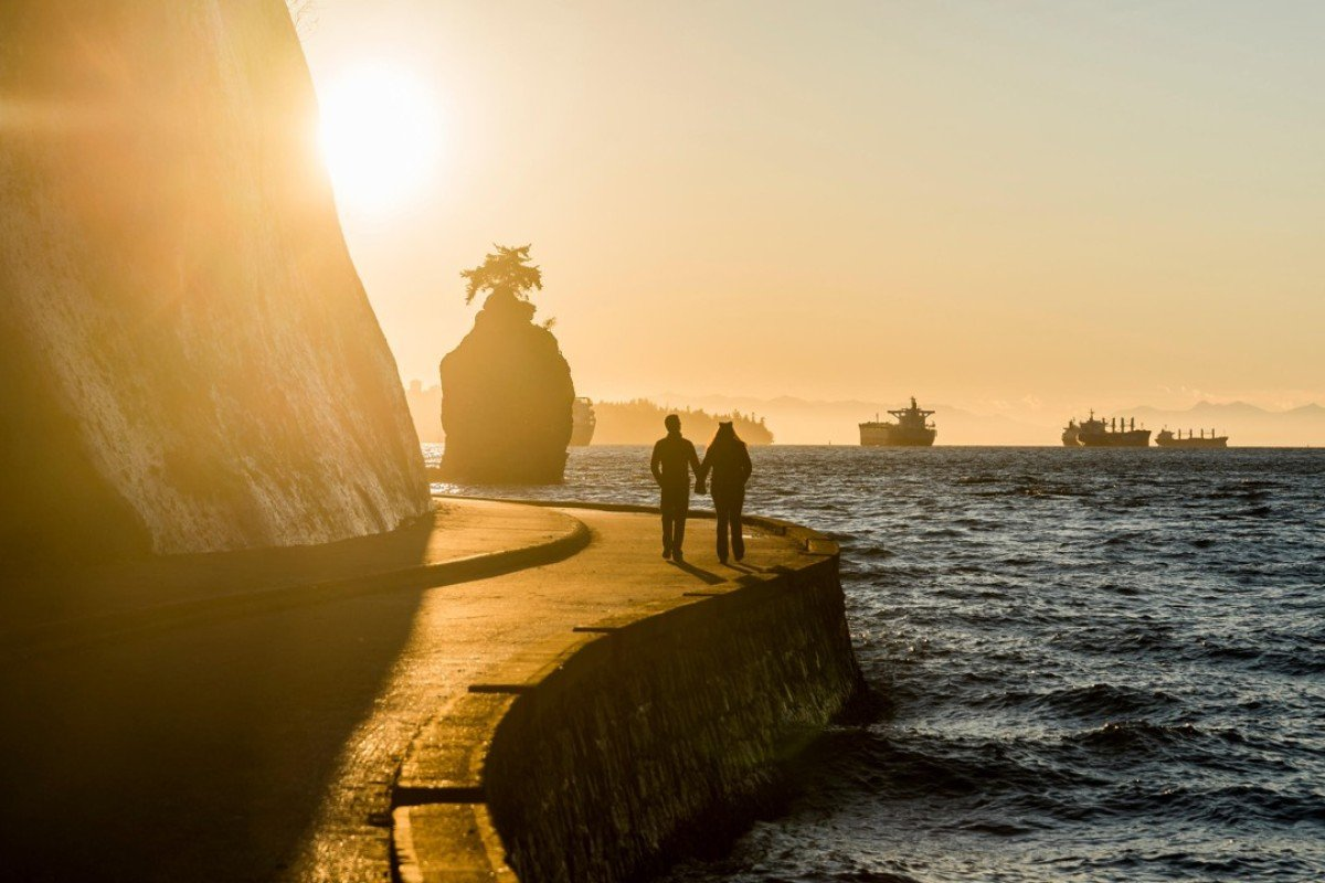 Stanley Park seawall at sunset, in Vancouver, Canada. Picture: Alamy