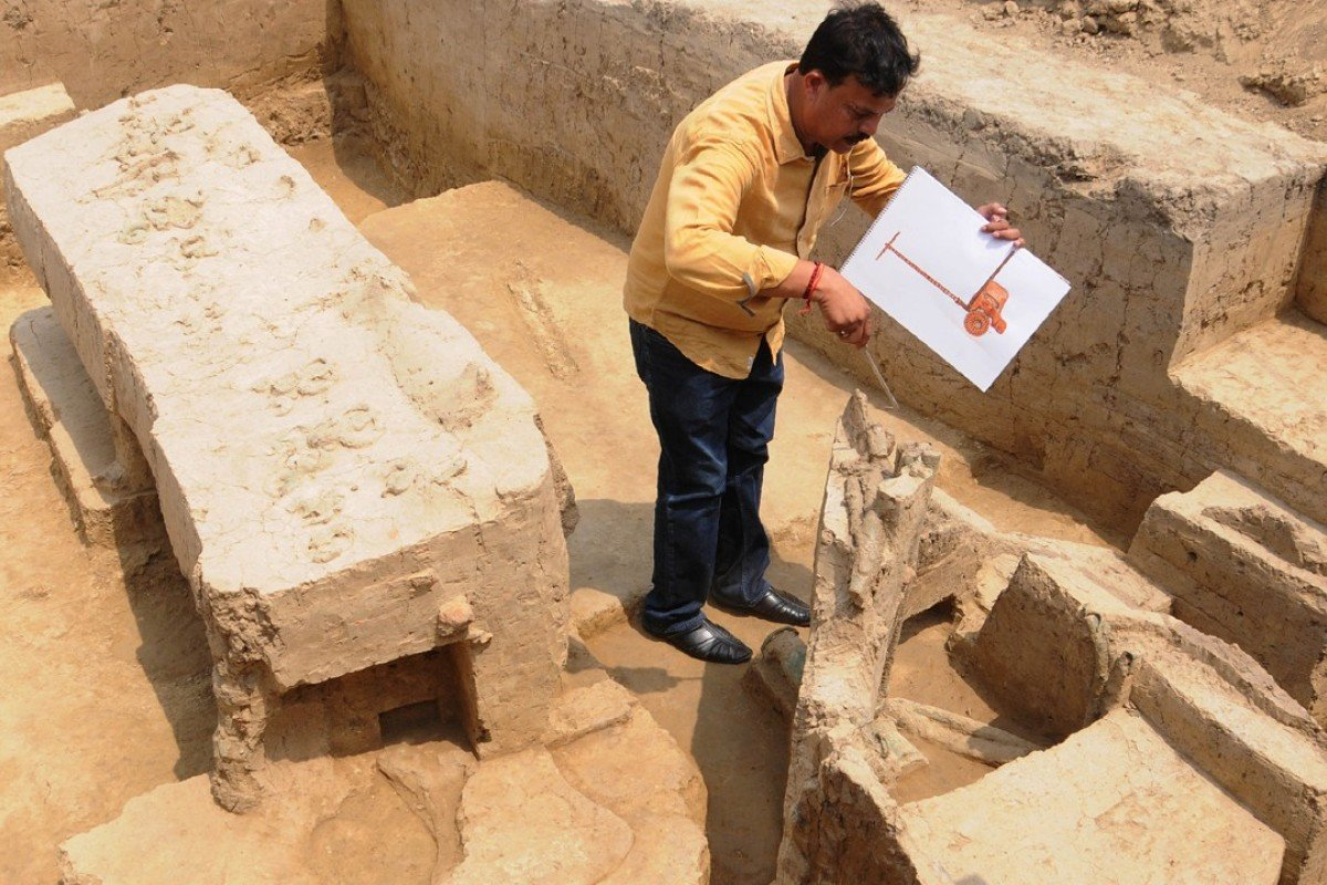 An archaeologist looks at the remains of a chariot belonging to the Indus Valley civilisation at an excavation site in Baghpat. Photo: AFP