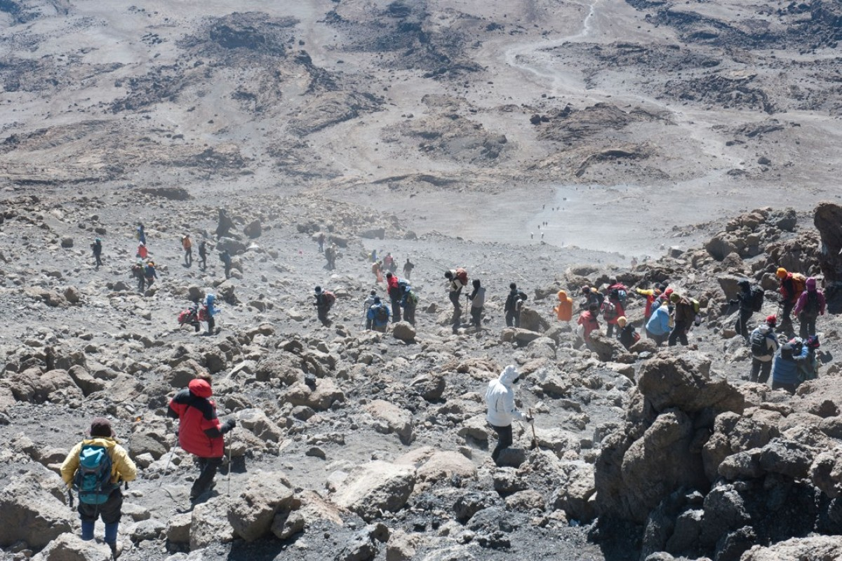 The dusty descent from Gilman's Point to the Kibo Huts campsite on Mount Kilimanjaro. Picture: Alamy