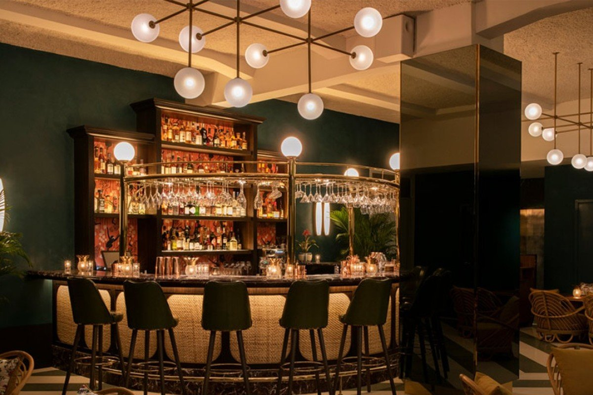 The bar at Straits Clan private club in Singapore, which stocks many rare whiskies and wines, features rattan furniture and onyx accents. Photos: Straits Clan