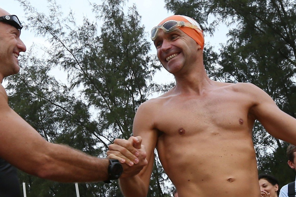 Olivier Baillet (right) and Bruce Pye start from Tai Pak Wan on their '75km Round Lantau Island Swim Challenge' in 2014. Baillet believes 'staying present' in mind helps physical performance. Photo: Nora Tam