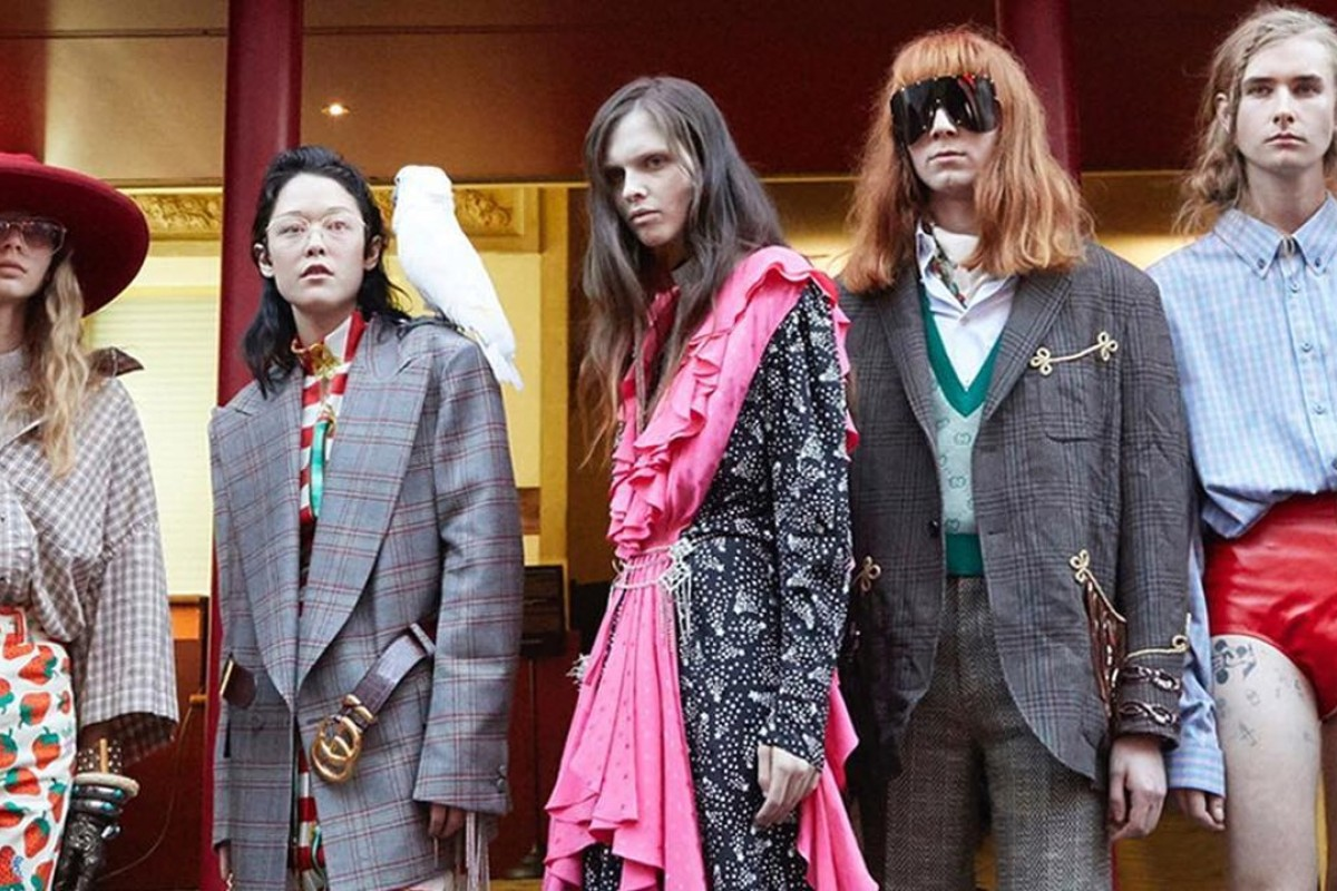Models pose in front of Théâtre Le Palace, a famed former nightclub and 1970s celebrity haunt turned theatre, where the Gucci spring-summer 2019 show was held.