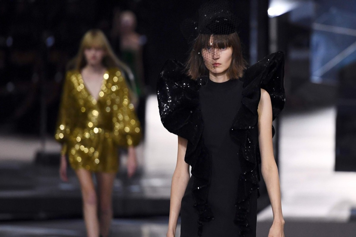 Designs in Hedi Slimane's collection for LVMH's Celine show during Paris Fashion Week on Friday were youthful, black, and rock 'n' roll – a bit like Kering's Saint Laurent. Photo: AFP