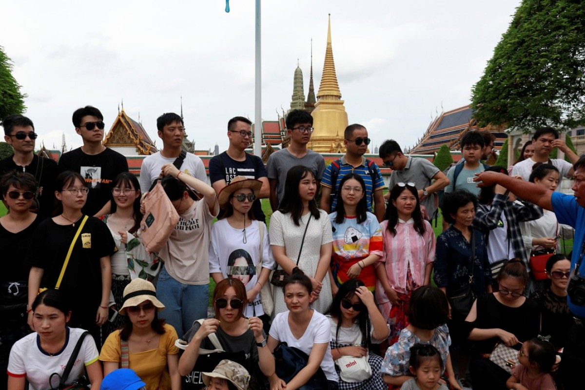 A group of Chinese tourists at the Temple of the Emerald Buddha in Bangkok, in August 2018. Picture: Reuters