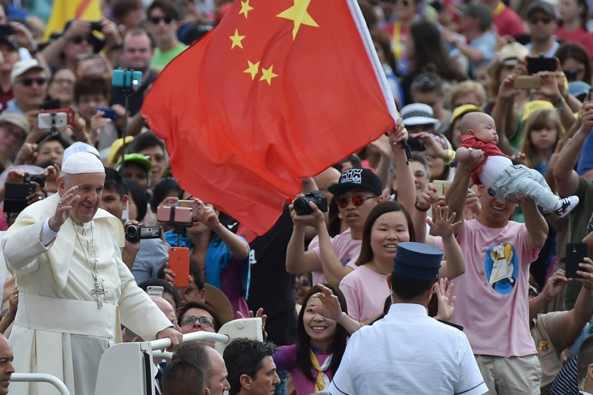 Pope Francis passes a Chinese flag as he greets the faithful in St Peter's Square, in Vatican City, in 2016. Picture: AFP