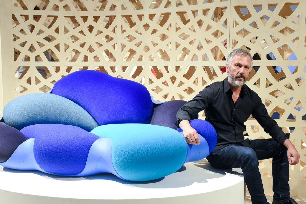 Humberto Campana and the Bomboca Sofa, a riot of organic shapes in shades of sea and sky, named after the confectionery served at Brazilian weddings. The sofa was designed for Louis Vuitton by Humberto and Fernando Campana. Photo: Joe Schildhorn/BFA.com