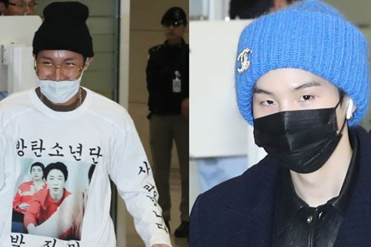 BTS members J-Hope (left) and Suga wear masks at Incheon International Airport on Tuesday after the boy band arrived back in South Korea after performing concerts in North America and Europe as part of its world tour. Photo: Yonhap