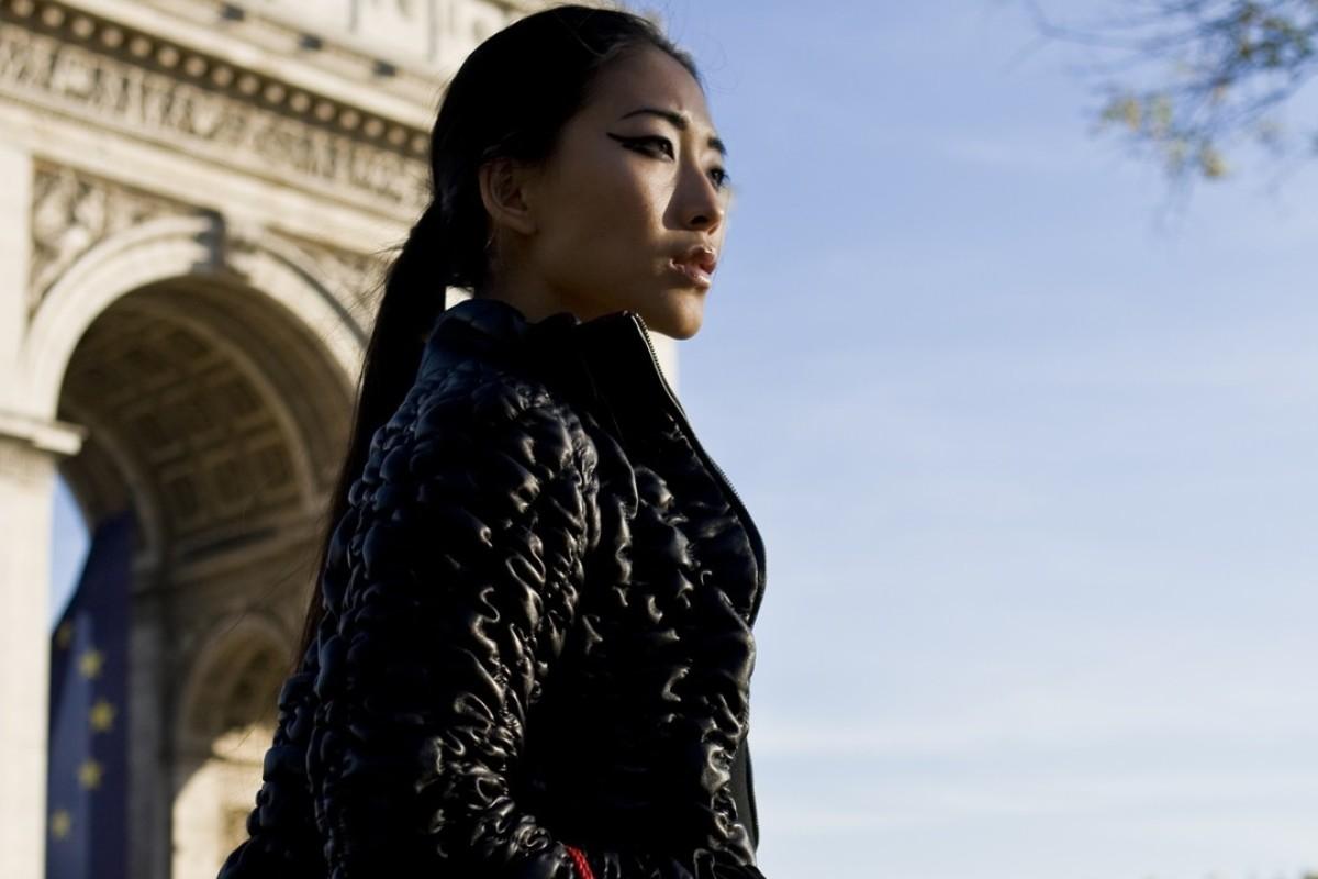 Fancy fashion model doing her shopping in Paris
