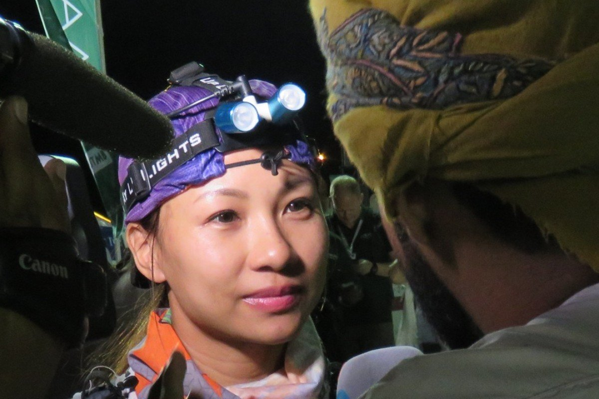 Samantha Chan being interviewed at the finish of the 2018 Oman by UTMB ultra race. Photos: Pavel Toropov