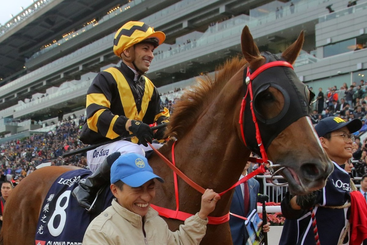 Glorious Forever and Silvestre de Sousa after winning the Longines Hong Kong Cup. Photo: Kenneth Chan