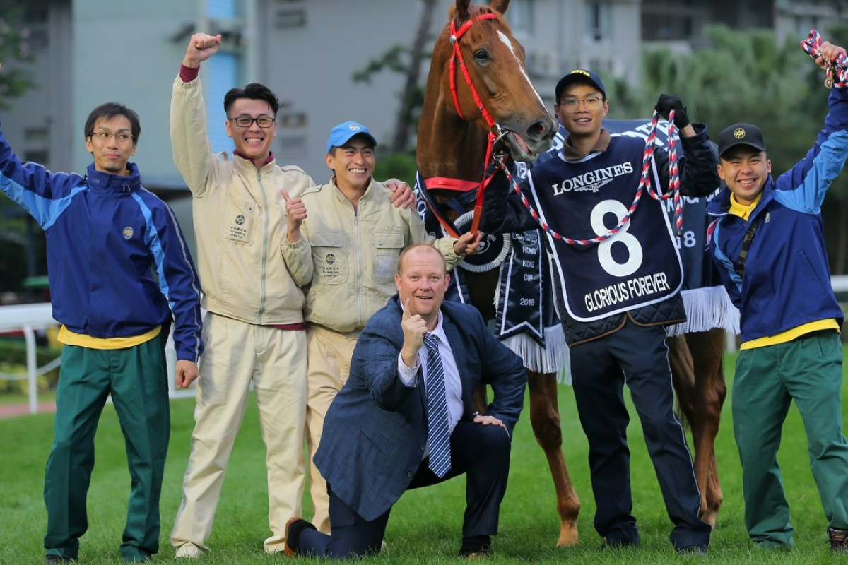Who is the mystery man (front, centre) lapping up Glorious Forever's Hong Kong Cup win? Photo: Kenneth Chan