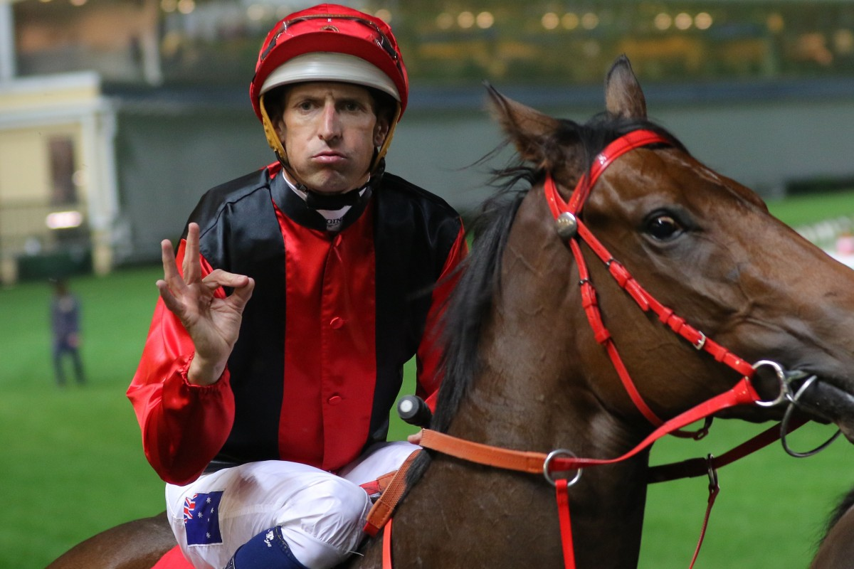 Jockey Hugh Bowman gives his trademark salute after winning on Country Star at Happy Valley. Photos: Kenneth Chan