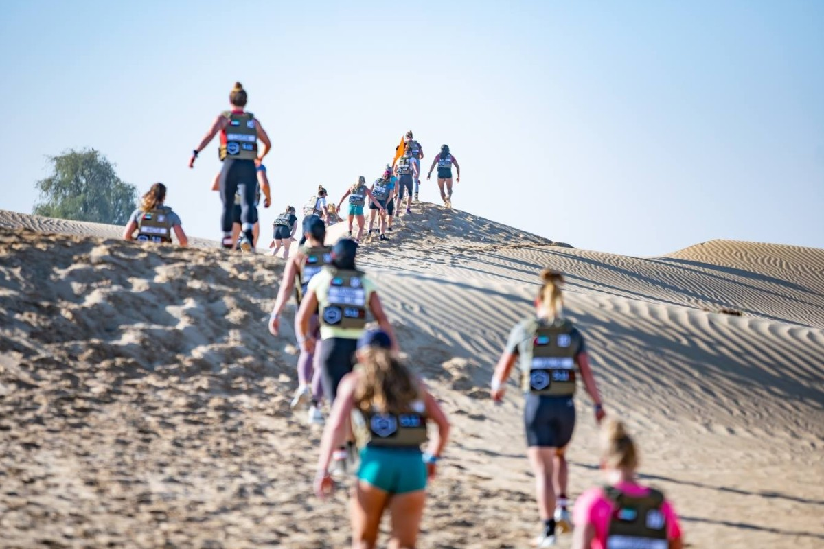 Female CrossFit athletes compete in a desert run in the first qualifying event of the new season. Photo: Dubai CrossFit Championship