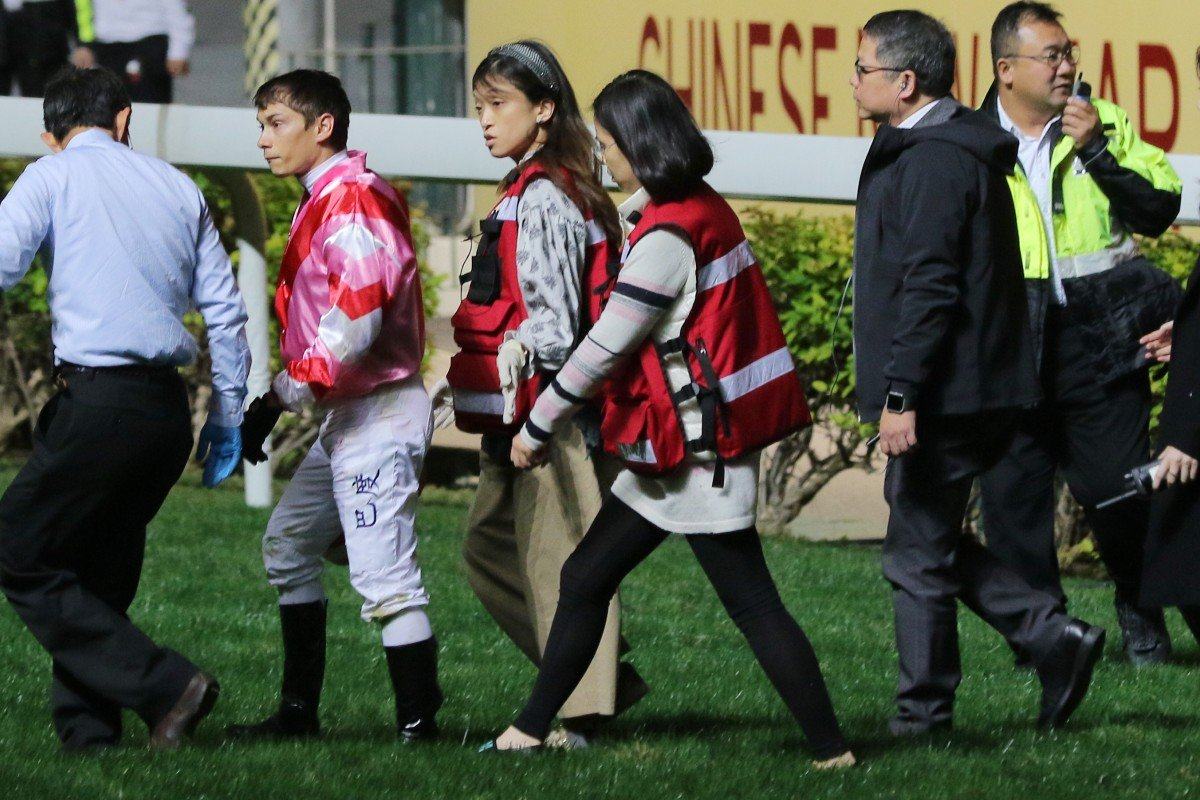 Alexis Badel walks back to scale after falling from Simply Brilliant. Photos: Kenneth Chan