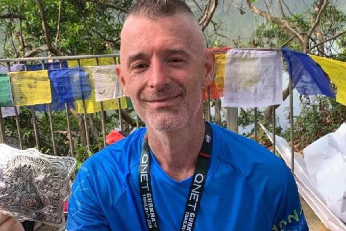 Nic Tinworth sits on the finish line of the Gurkha Trailblazer. Only seven months ago he had to re-learn how to walk, but he finished the course in under two hours. Photo: Handout