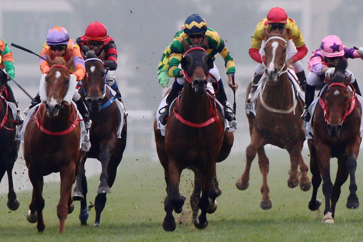 Hugh Bowman (blue, green and yellow silks) wins the Classic mile with Furore. Photos: Kenneth Chan