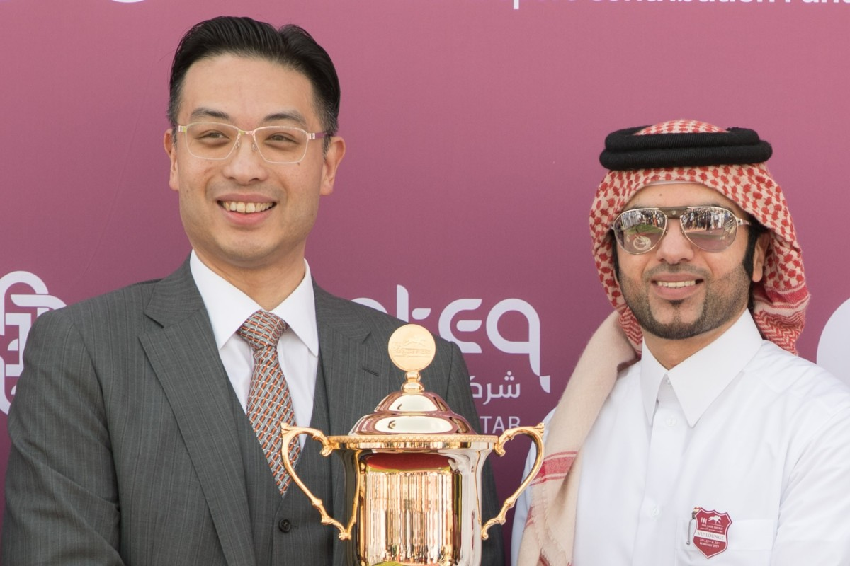 Johnny Hon receives the trophy after Global Spectrum's victory in Qatar. Photos: juhaim@qrec