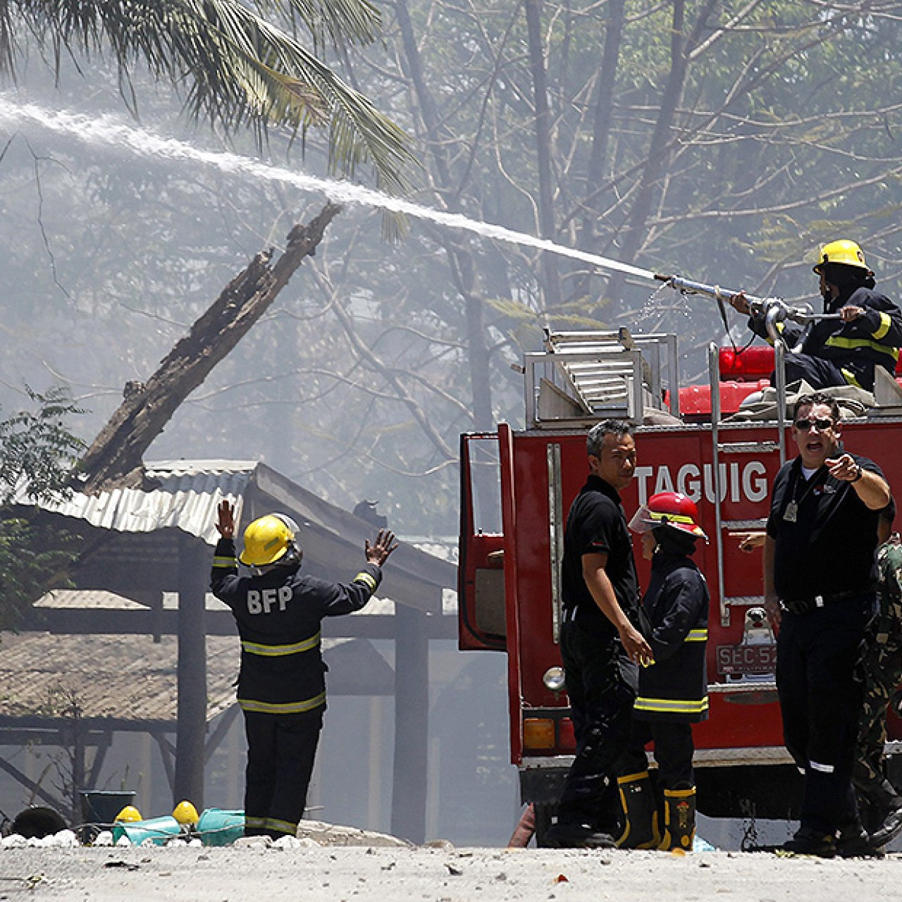 23 hurt as fire and blasts rock Philippines army munitions depot