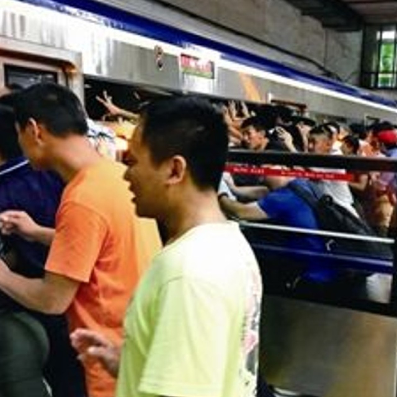 People power saves Chinese man crushed between subway train